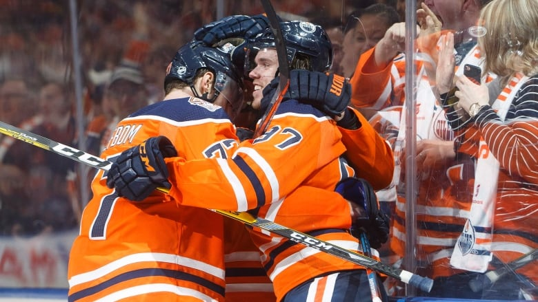 Bruins force overtime to earn point, but fall to Oilers