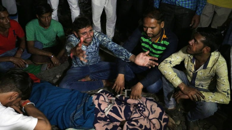 Indian town picks up pieces after train kills 60 people watching fireworks