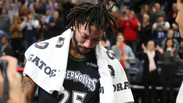 27742d867fba Minnesota Timberwolves  Derrick Rose composes himself before a television  interview after he scored a career-high 50 points against the Utah Jazz on  ...