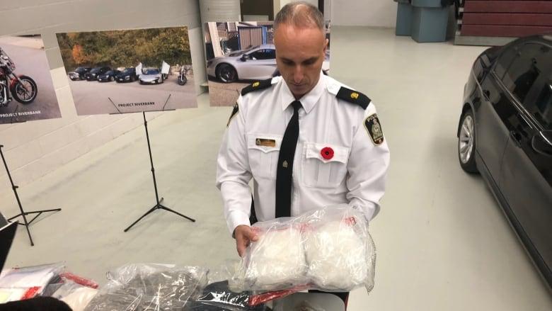 Police bust major western Canadian crime network, seize $2 7