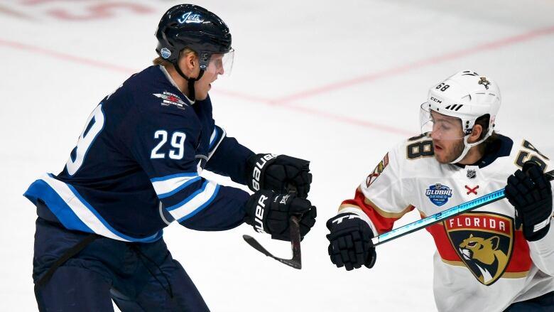 2b1decea148 Winnipeg s Patrik Laine battles Florida s Mike Hoffman Friday during the  Panthers  4-2 win in Helsinki
