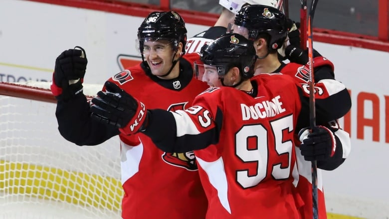 Ottawa Senators  Colin White (36) celebrates his goal against the New  Jersey Devils with Matt Duchene (95) and Mark Stone (61) during the second  period on ... 8ae7eb376