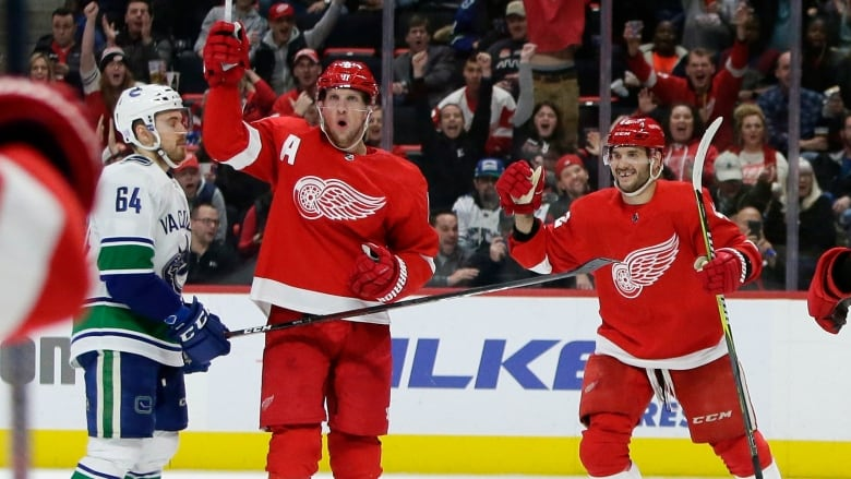 a7689066d Detroit Red Wings left wing Justin Abdelkader (8) celebrates his goal with  right wing Martin Frk (42), during the second period.