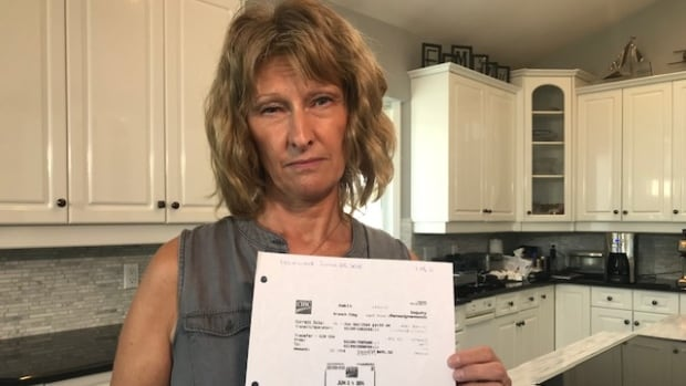 Image for 'Woman battles bank for 2 years for information on her own account'