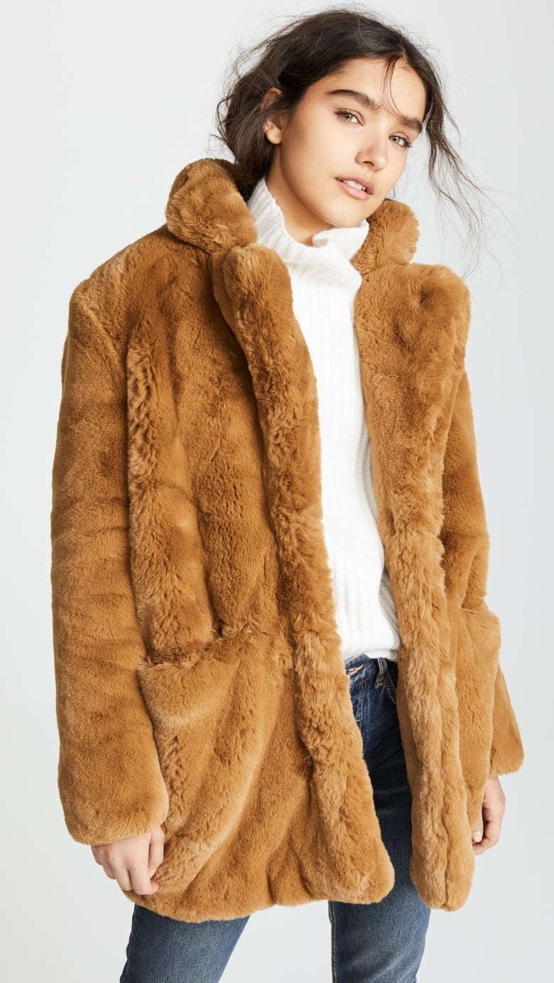 771c324ea5b7 Inspired by vintage styles found in second-hand shops, this line nails the  look of an old school fur with vegan materials, and we love the shape and  high ...