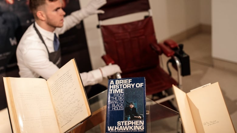 Stephen Hawking's wheelchair and thesis fetch more than US$1m at auction