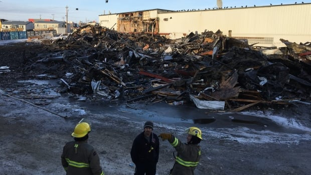 Iqaluit's Northmart fire extinguished overnight, federal support pledged | CBC News