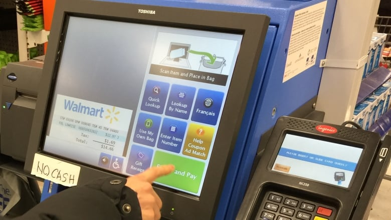 Walmart ramps up self-checkout, scales down 'scan and go' shopping