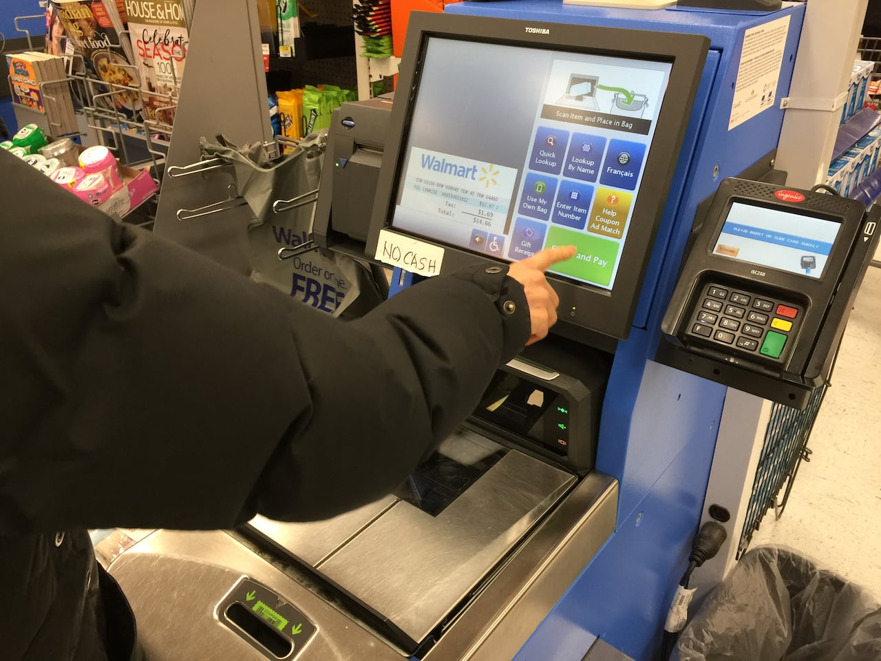 Walmart ramps up self-checkout, scales down 'scan and go
