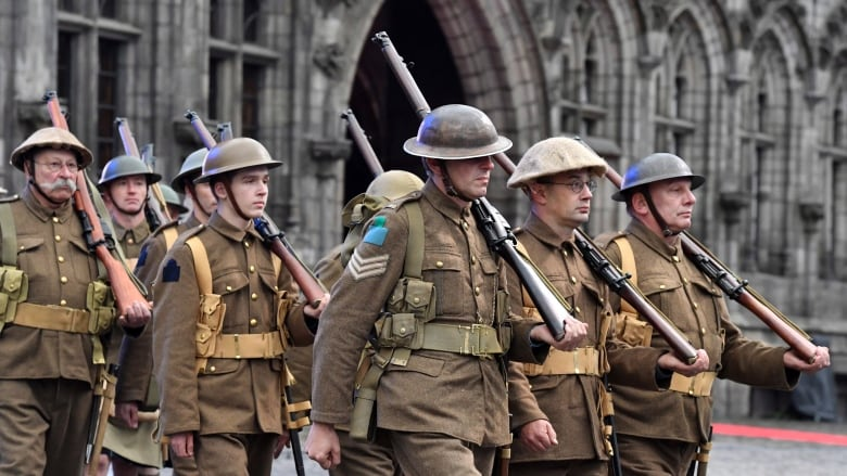 Living history actors in First World War uniforms reenact the liberation of  Mons 4dd1b3485