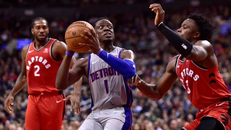 Detroits Reggie Jackson looks to the basket as Toronto forward OG Anunoby  defends during the second half of the Pistons 106-104 win over the Raptors  in ...
