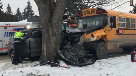SUV driver hospitalized after crash with Saskatoon school bus