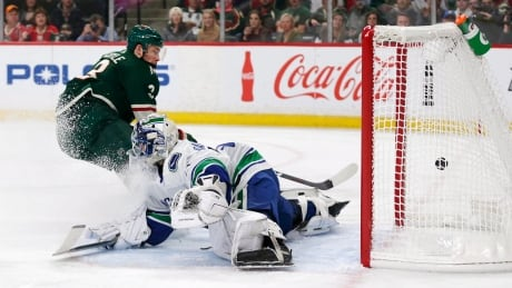 Wild pour it on Canucks' Bachman in return to NHL