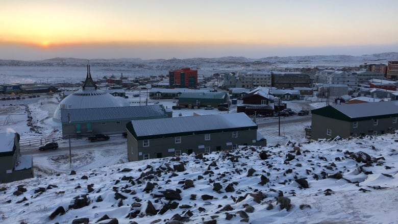 city of Iqaluit with a sunset in the background
