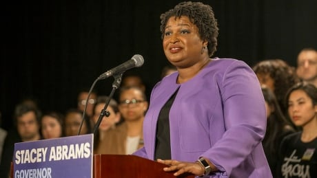 Democrat admits defeat in hard-fought Georgia governor race, vows to sue