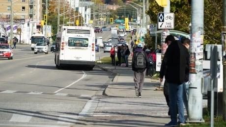 Students outside Wilfrid Laurier University in Waterloo, Ontario on University Avenue
