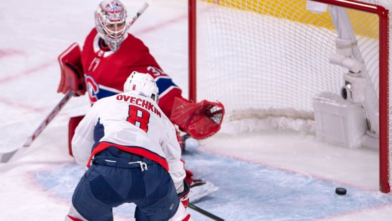 dfbd0ba5b Washington Capitals left wing Alex Ovechkin (8) scores against Montreal  Canadiens goaltender Carey Price (31) during the first period on Monday  night.