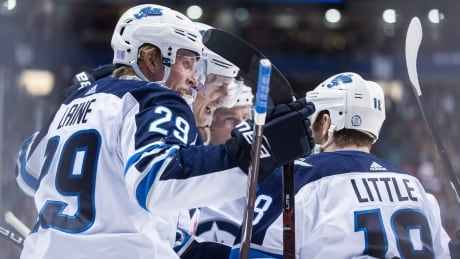 Laine's hat trick lifts Jets past Canucks
