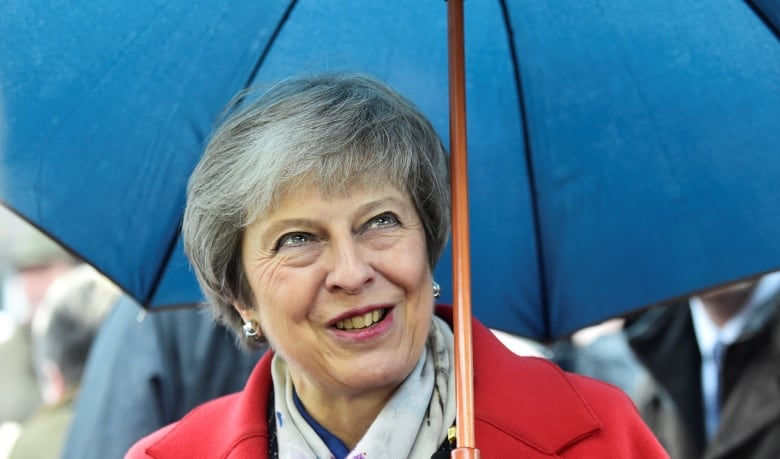 May defends draft Brexit deal