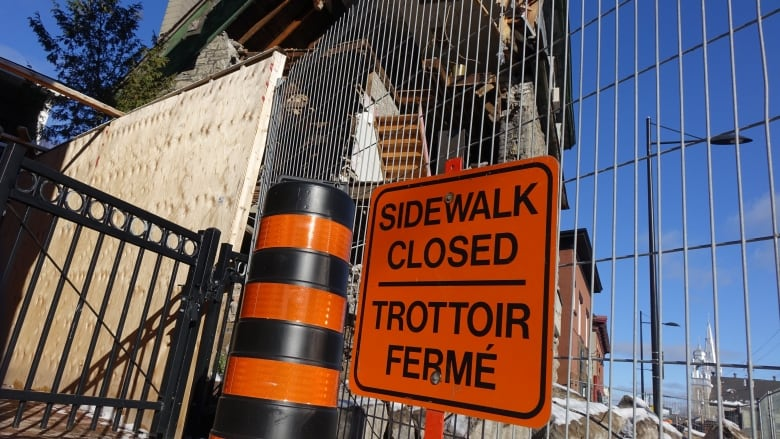 Reopen sidewalk near Magee House, businesses urge | CBC News