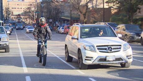 Cyclist car side by side