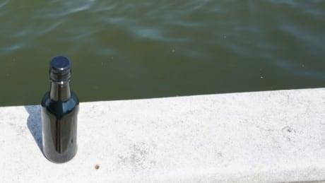 bottle liquor boat water