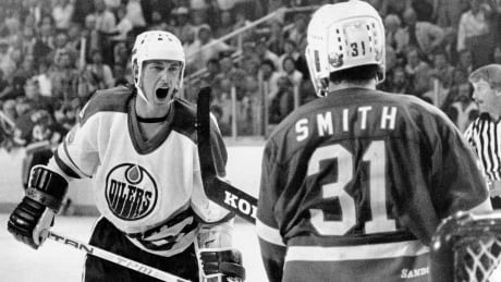 Wayne Gretzky and Billy Smith during the 1983 Stanley Cup playoffs
