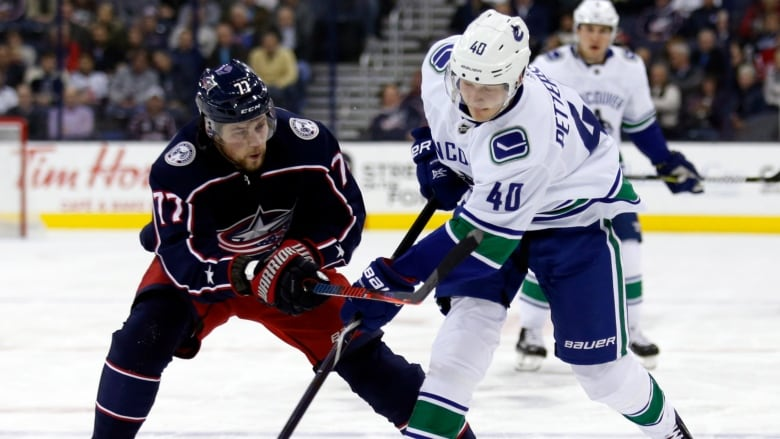 brand new f70c5 af9a6 Canucks rally with 3-goal 3rd period to edge Blue Jackets ...