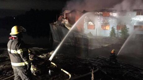 Mission fire crews battling barge blaze on Fraser River