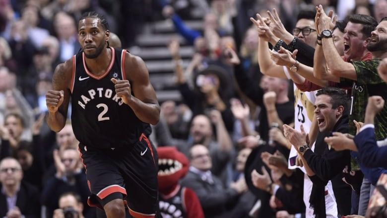 103922cff Fans cheers after Toronto Raptors forward Kawhi Leonard makes a basket  against the Denver Nuggets earlier in December. (Nathan Denette The  Canadian Press)