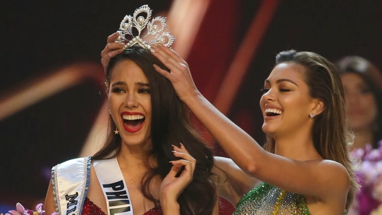 2a80b75c47b0 Catriona Gray of the Philippines, left, reacts as she is crowned the new Miss  Universe 2018 by her predecessor, Miss Universe 2017 Demi-Leigh Nel-Peters,  ...