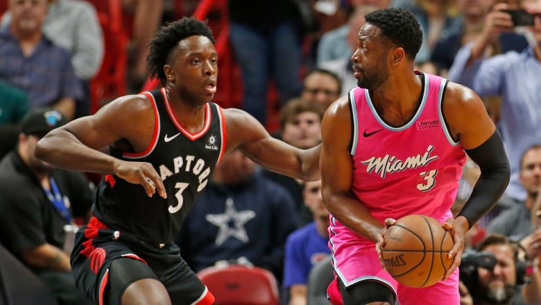 624f6055205 Toronto Raptors forward OG Anunoby, left, defends against Miami Heat guard  Dwyane Wade during the first half in Miami on Wednesday.