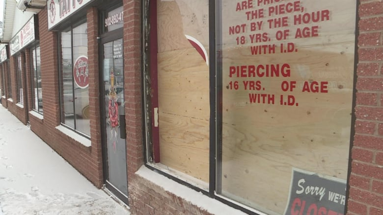 c52b98342b557 The outside of Extreme Ink tattoo shop in Charlottetown was damaged during  an altercation on Dec. 23. (Brian Higgins/CBC News)