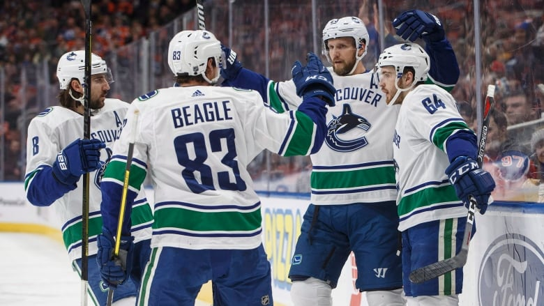 580fc663d Vancouver Canucks players celebrate a goal against the Edmonton Oilers  during first period along the way to a 4-2 win on Thursday in Edmonton.