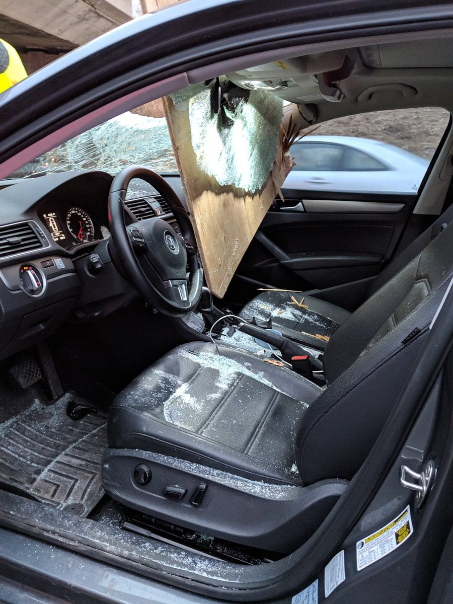 Plywood smashes into car narrowly missing driver on Hwy  410