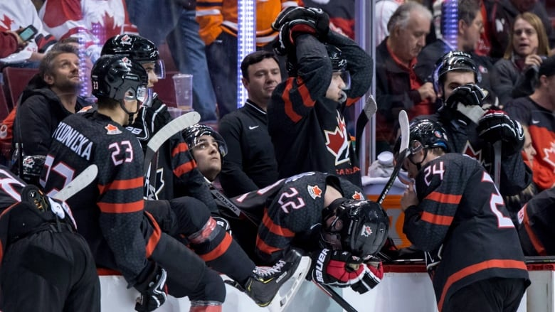 d970ecae182 Canada s Alexis Lafreniere (22) hangs his head after losing to Finland in  overtime of the quarter-final IIHF world junior hockey championship in  Vancouver ...