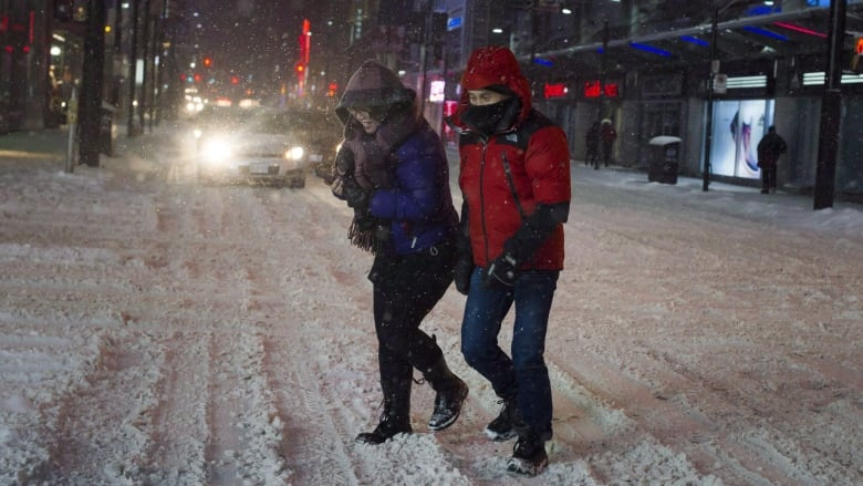 Drivers Are Killing More Pedestrians In Canada Every Year Heres  A Couple Is Seen Traversing The Yonge And Dundas Intersection During A Snow  Storm In Toronto In A March   File Photo As The Number Of  Pedestrian