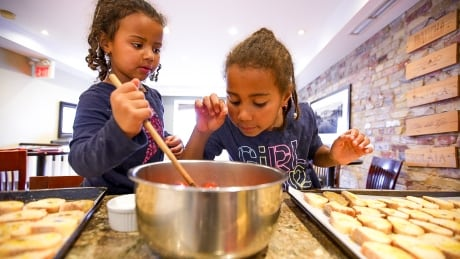 Young children learning to cook