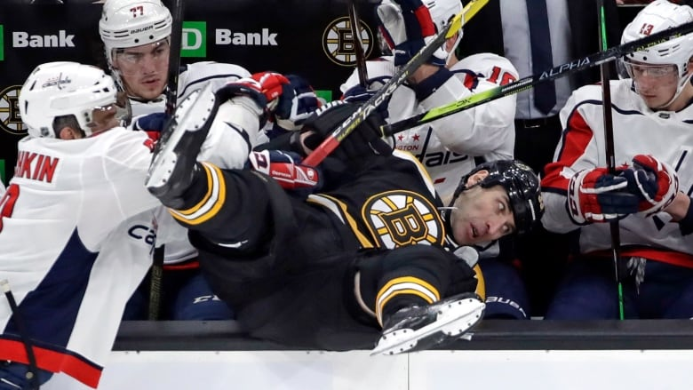 Washington s Alex Ovechkin sends six-foot-nine Boston defenceman Zdeno  Chara tumbling into the Capitals  bench during their game on Thursday. 94c43a7acc7