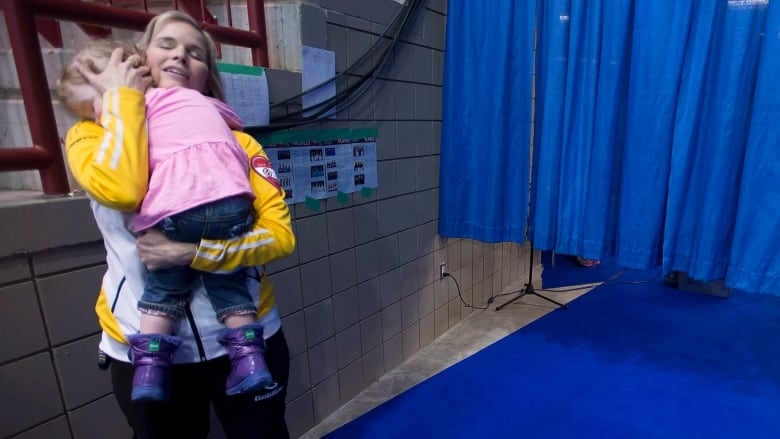 8b14fc809deca Jennifer Jones takes a moment to comfort her then two-year-old daughter at  the 2015 Scotties Tournament of Hearts. (Jonathan Hayward/Canadian Press)