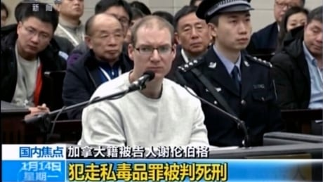 China shrugs off international criticism over death sentence for Canadian