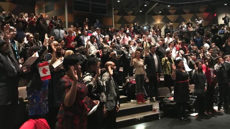 114 new Canadians take citizen oath in Sudbury | CBC News