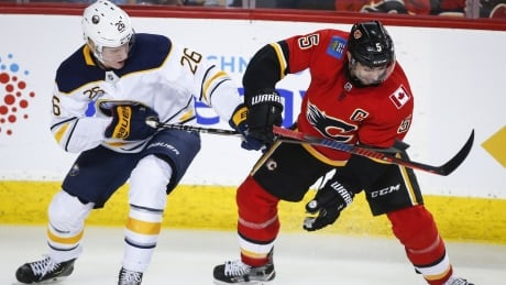 Sabres edge Flames in OT to end 4-game skid