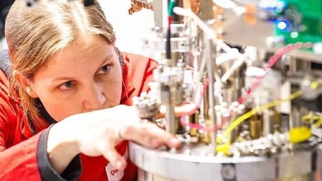 general fusion woman works on fusion device component