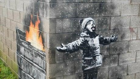 Banksy mural of child playing in falling ash sold to U.K. art dealer