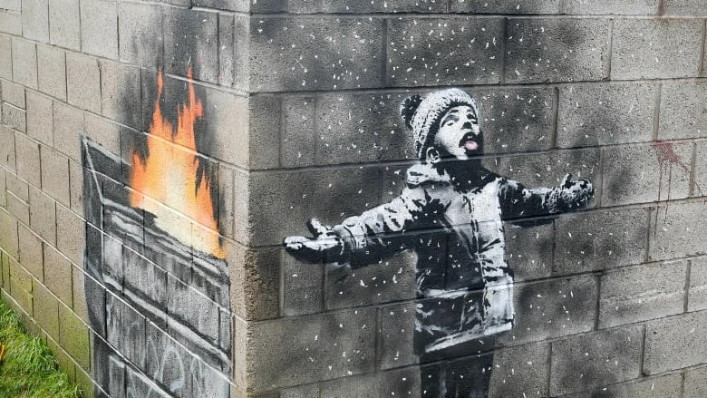 Banksy artwork found on garage in Wales sold for six-figure sum
