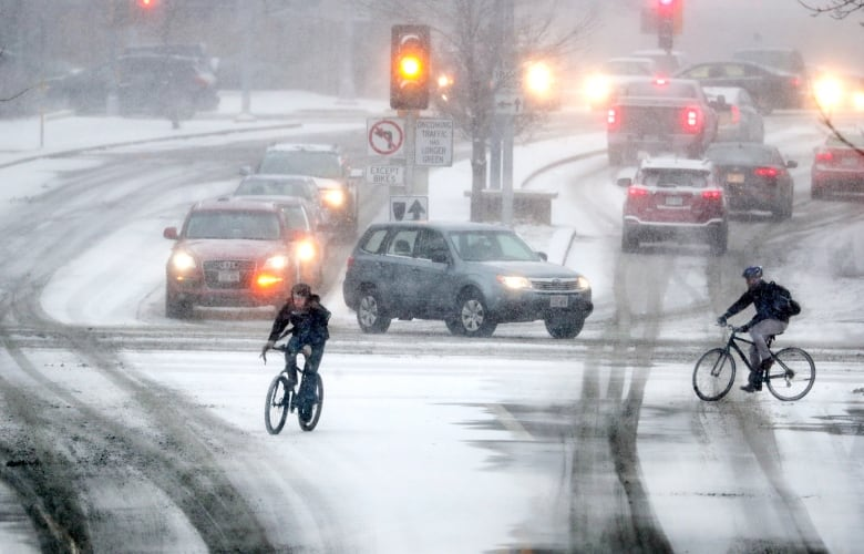 Canceled flights, delayed trains and icy roads as winter storm moves east