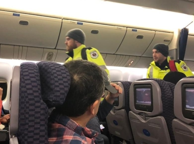 Passengers shiver through 13-hour ordeal on Canadian tarmac
