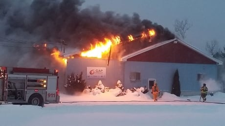 60 firefighters tackle fire at business west of Fredericton