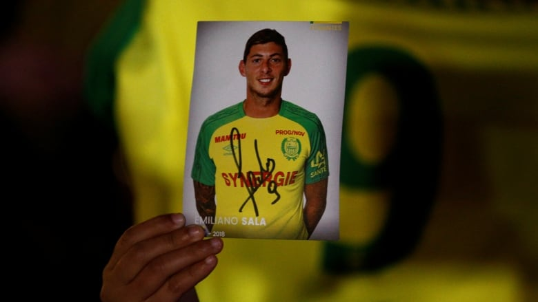 2f2d8c79f A fan holds a portrait of Argentinian soccer player Emiliano Sala in  Nantes